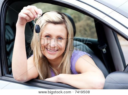 Happy Young Driver Holding A Key After Bying A New Car
