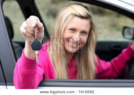 Smiling Driver Showing A Key After Bying A New Car