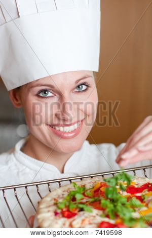 Radiant Female Chef Cooking A Pizza