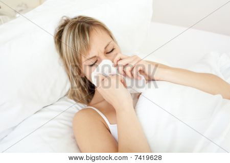 Sick Woman Blowing Lying On Her Bed