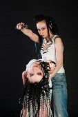 foto of gun shot wound  - two white girl with handguns on black background - JPG