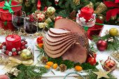 picture of christmas spices  - Christmas dinning table with glazed roasted ham with tomatoes herbs and kumquats - JPG
