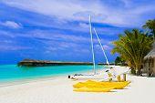 stock photo of kuramathi  - Yacht on tropical beach  - JPG