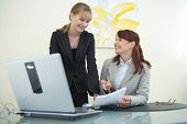 stock photo of human resource management  - two businesswomen are discussing the work - JPG