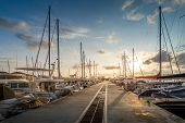 image of sailing vessels  - Sunrise at the sailing boats pier - JPG