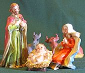 foto of manger  - Mary and Joseph with the child Jesus in the Manger of the crib at Christmas - JPG
