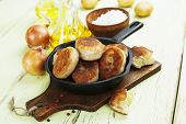 pic of patty-cake  - Patties with potatoes in a cast iron frying pan - JPG