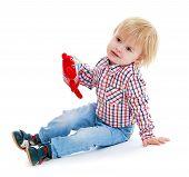 stock photo of montessori school  - Little boy sitting on the floor teddybear  - JPG