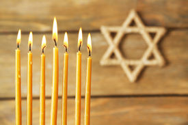 picture of torah  - Hanukkah candle on wooden background - JPG