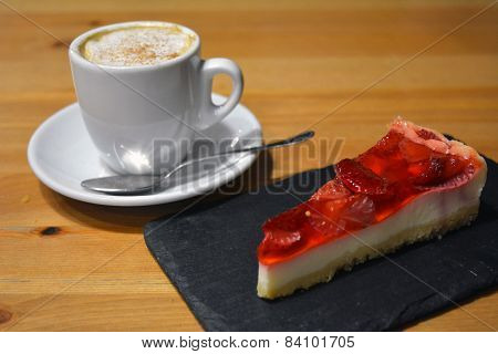 Fresh strawberry dessert with cup of cappuccino