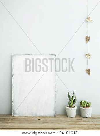 Scandinavian Style Home Decoration. Old Wooden Poster With Succulents In Concrete Pots.