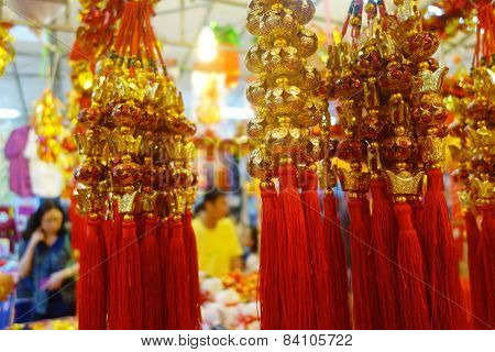 Customers Shop For Chinese New Year Ornaments Displayed In A Singapore Local Market
