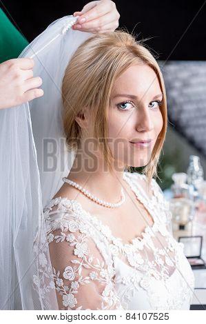 Bride Prepares And Dresses Veil