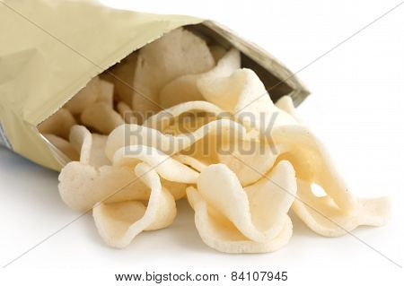 Open packet of prawn crackers on white