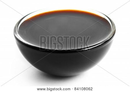 Soja sauce in small glass dish.