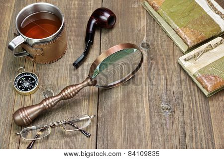 Adventures Or Travel Or Expedition Items On Wooden Table