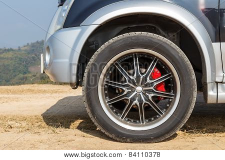 Car Wheel On Mountain