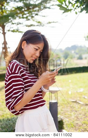 Young Beautiful Woman Connecting By Chat And Reading Message In Smart Phone  Use For Modern People A