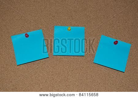 Blue Post it Notes on a Cork Board