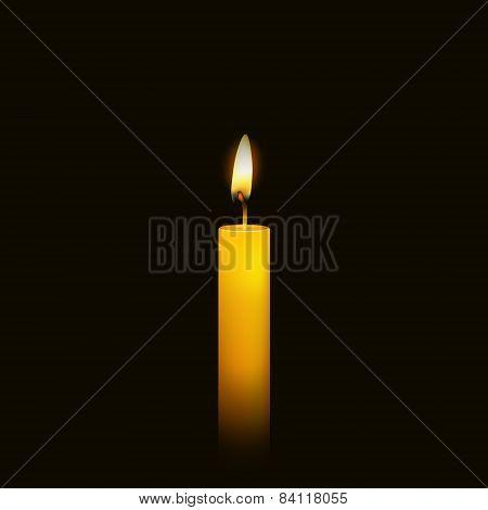 Burning candle over black.