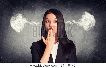 Kissing woman with steam from ears. Concrete gray as backdrop