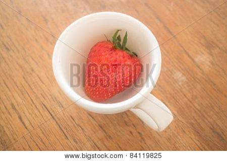 Single Fresh Ripe Strawberry In White Mug