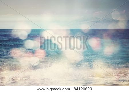 Background Of Blurred Beach And Sea Waves With Bokeh Lights And Vintage Filter/impact