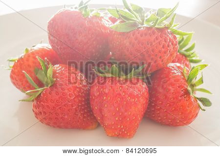 Fresh Ripe Strawberries On White Plate