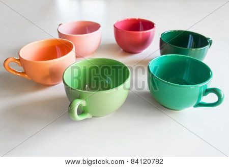 Colored Cup's On A White Table
