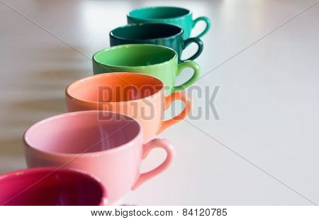 Multicolor Cup's On A Whie Table
