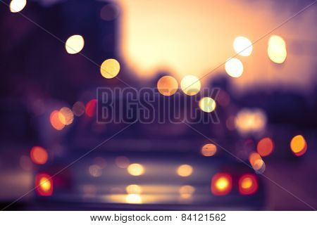 Beautiful Background Of Bokeh Lights At Night On Road With Car