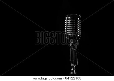 Vintage retro microphone isolated on black background