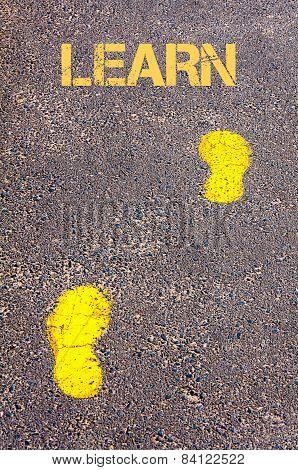 Yellow Footsteps On Sidewalk Towards Learn Message