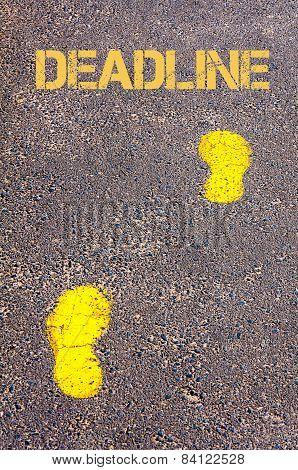 Yellow Footsteps On Sidewalk Towards Deadline Message