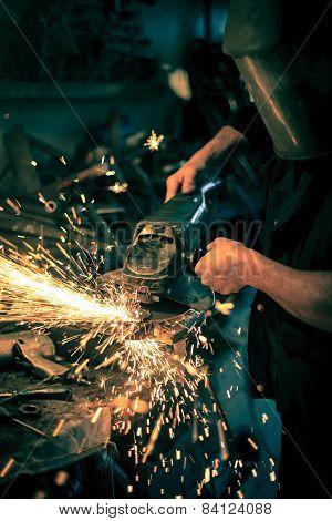 Metal Grinding On Steel Spare Part In Workshop