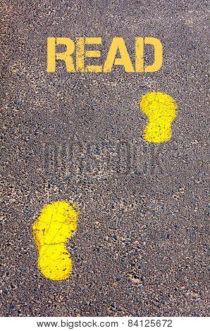 Yellow Footsteps On Sidewalk Towards Read Message