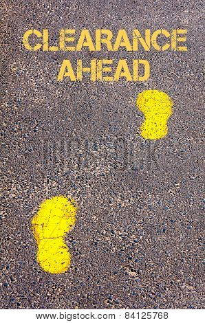 Yellow Footsteps On Sidewalk Towards Clearance Ahead Message