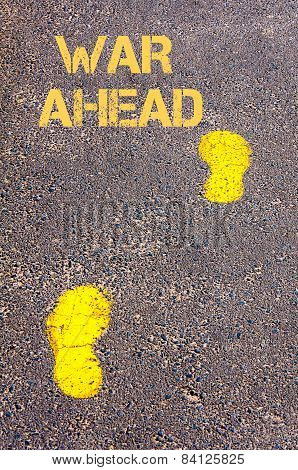Yellow Footsteps On Sidewalk.war Ahead Message