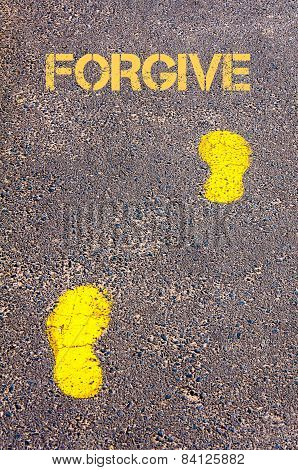 Yellow Footsteps On Sidewalk Towards Forgive Message