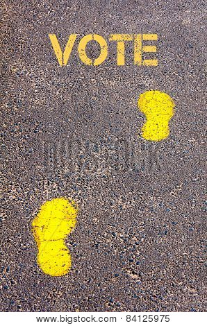 Yellow Footsteps On Sidewalk Towards Vote Message
