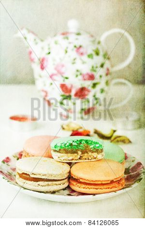 Traditional French Macarons and tea set with retro filter effect