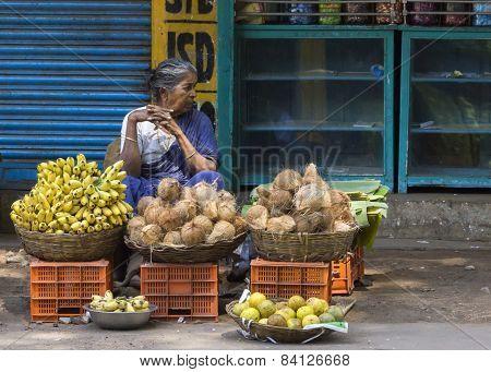Woman Sells Coconuts And Bananas.