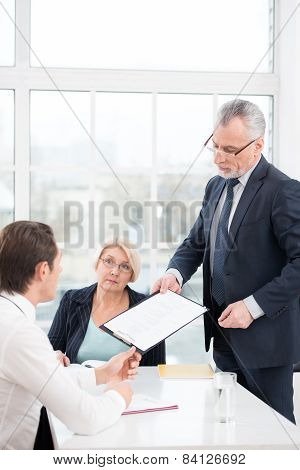 Employer giving prospective employee to complete a questionnaire
