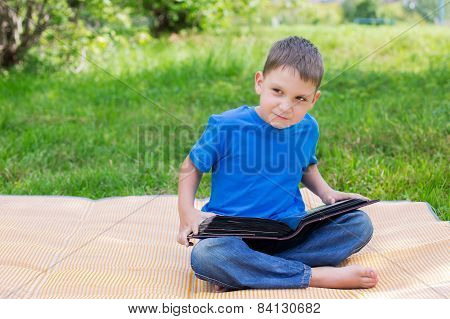 Boy Sitting With Opened Album