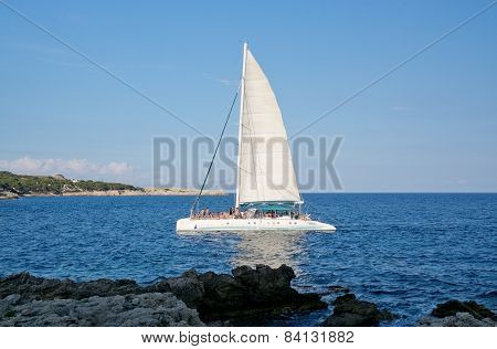 Party sailboat with celebrating crowd