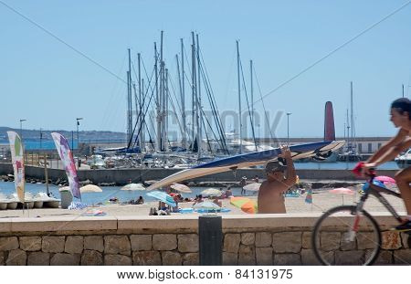 Street scene with surfer masts and cyclist