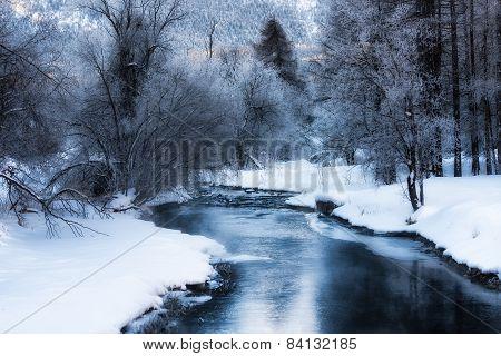 Frozen River In Winter Mountain