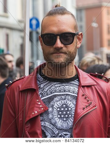 Man Outside Alberto Zambelli Fashion Show Building For Milan Women's Fashion Week 2015