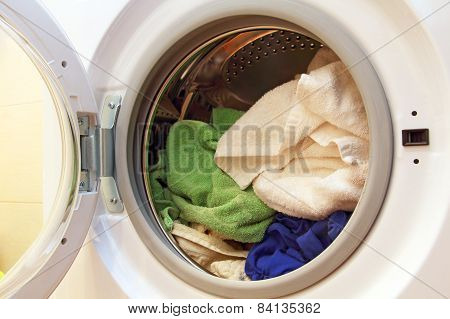 Clothes Inside Of Washing Machine.