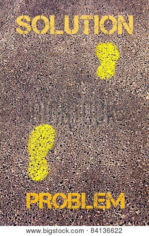 Yellow Footsteps On Sidewalk From Problem To Solution Message. Concept Image